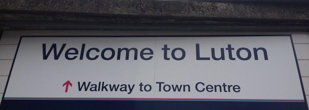 Welcome to Luton sign at the Midland Road entrance to Luton train station