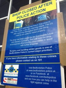police sign on shop window