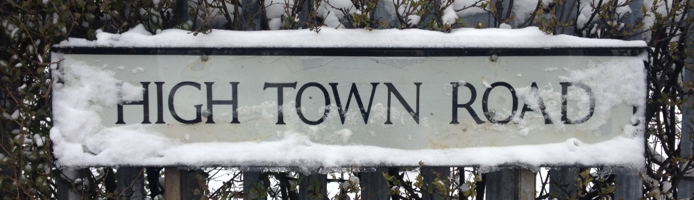 High Town Road sign, covered by snow.