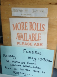 (Name and details of the funeral have been obscured.)