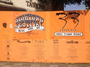 High Town (or 'Hightown') Festival sign in front of the now sadly fire-ravaged premises of the former pub, the Railway Tavern.