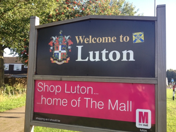Welcome to Luton sign with Mall advertisement